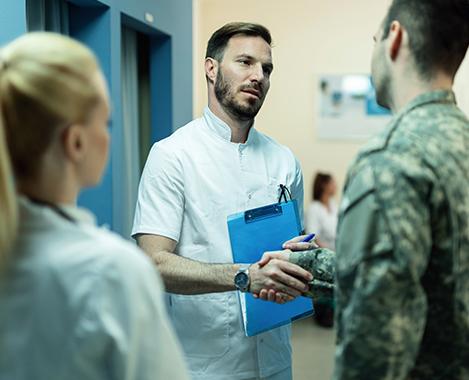 doctor shaking veteran's hand